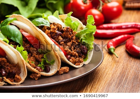 beef taco on the plate with vegetable Stock photo © M-studio