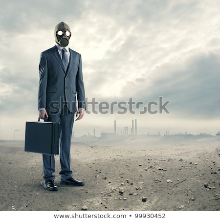 portrait of businessman in a gas mask  with suitcase Stock photo © stokkete