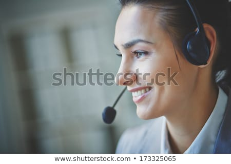 portrait of female customer support executive stock photo © stockyimages