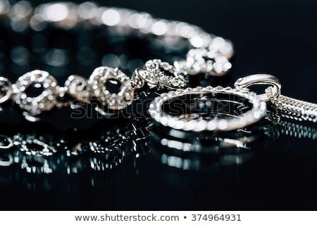 Silver jewelry on black Stock photo © manaemedia