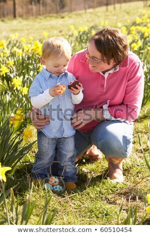 Сток-фото: Mother And Son On Easter Egg Hunt In Daffodil Field