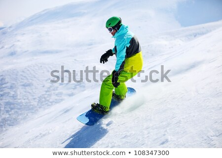 Young Boy Snowboarding Down Slope On Holiday In Mountain Stock photo © monkey_business