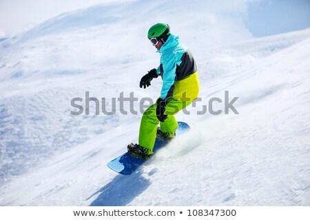 Snowboard vers le bas pente vacances montagne Photo stock © monkey_business