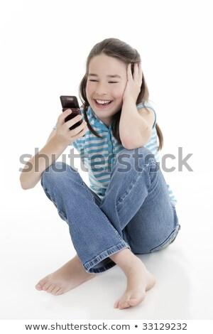 Studio Shot Of Teenage Girl Sending Text Message Stock photo © monkey_business