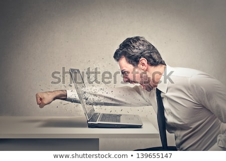 businessman   laptop smash stock photo © dgilder