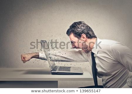 üzletember laptop izolált stúdiófelvétel laptop számítógép bemozdulás Stock fotó © dgilder