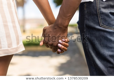 Stock photo: Young married couple holding hands