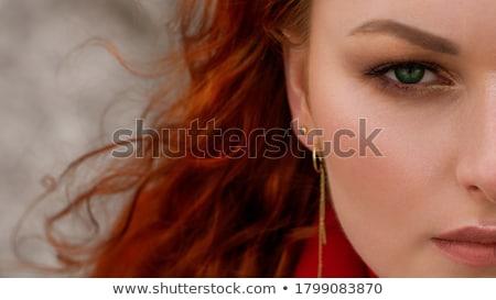 portrait of beautiful red hair woman in black stock photo © dariazu