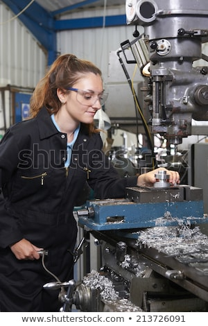 Female Apprentice Engineer Working On Drill In Factory Stock photo © HighwayStarz