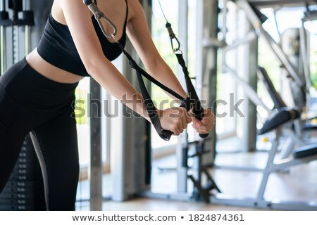 Standing Cable Crossover Fly flies woman workout Stock photo © lunamarina