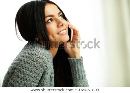 jonge · gelukkig · nadenkend · vrouw · smartphone · muziek - stockfoto © deandrobot