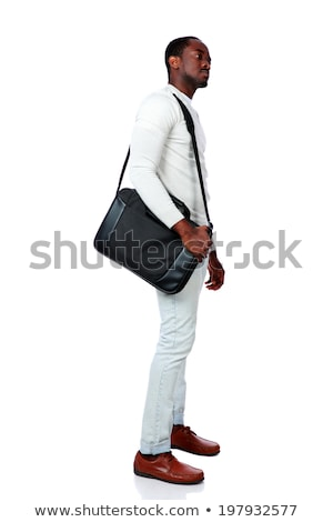 side view of a serious african man standing with bag over white background stock photo © deandrobot