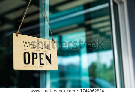 Stock photo: Red sign in front of a white wooden wall - Welcome