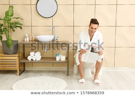 man in toilet reading newspaper stock photo © andreypopov
