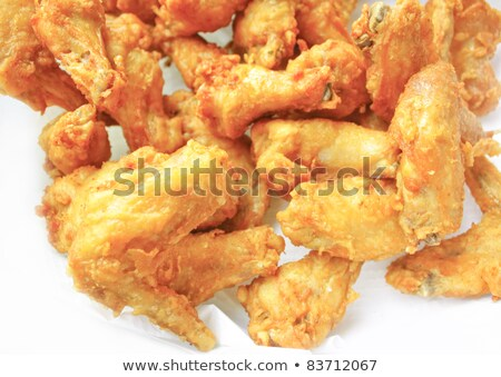 large dish with chicken wings and fries stock photo © ironstealth