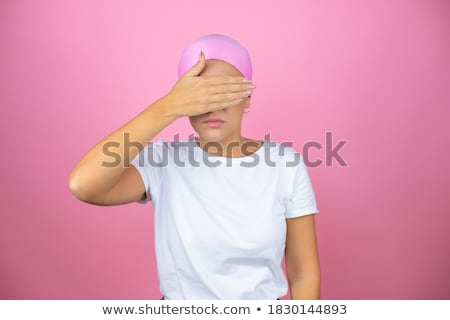 woman covering her breast with her hands stock photo © nobilior