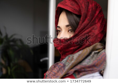 Serious looking woman with oriental make-up   Stock photo © Elisanth