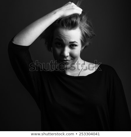 Dark theme portrait of a young woman Stock photo © konradbak