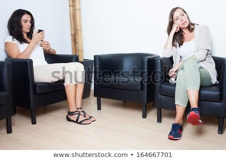 Iki kadın oturma bekleme odası doktorlar kadın gülümseme Stok fotoğraf © ambro
