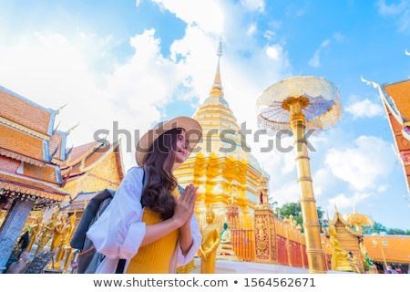 Buddhist woman praying at temple Stock photo © smithore