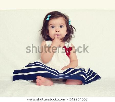 baby girl sucking fingers stock photo © mikko