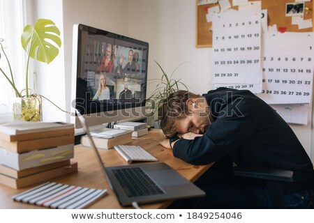Photographer sleeping at his workplace Stock photo © deandrobot
