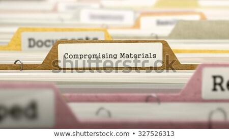 folder in catalog marked as compromising materials stock photo © tashatuvango