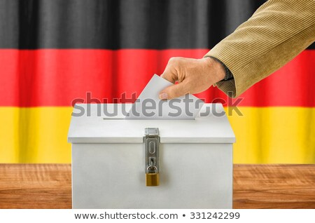 Man putting a ballot into a voting box - Germany Stock photo © Zerbor