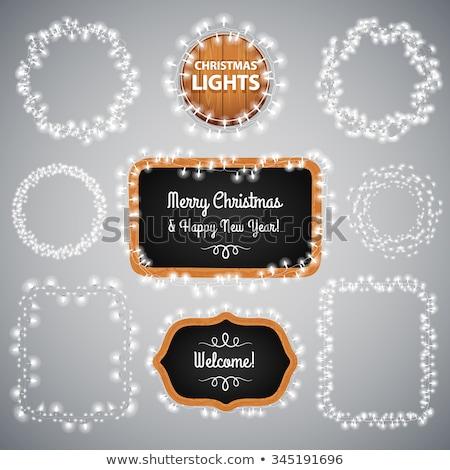 white christmas lights on blackboard stock photo © voysla