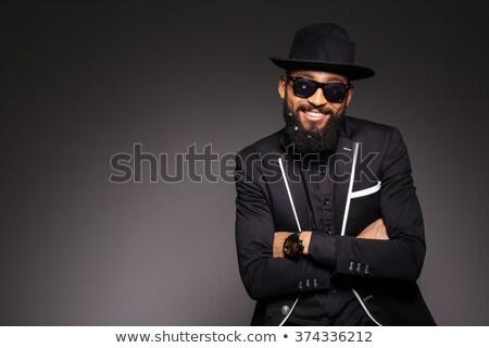 glimlachend · stijlvol · afro · amerikaanse · jonge · man · zonnebril - stockfoto © deandrobot