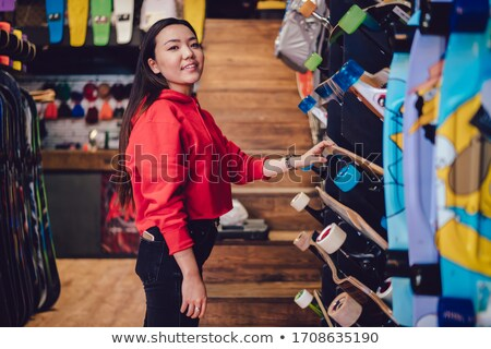 Charming woman posing with skateboard Stock photo © deandrobot