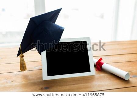 Közelkép táblagép diploma oktatás érettségi technológia Stock fotó © dolgachov