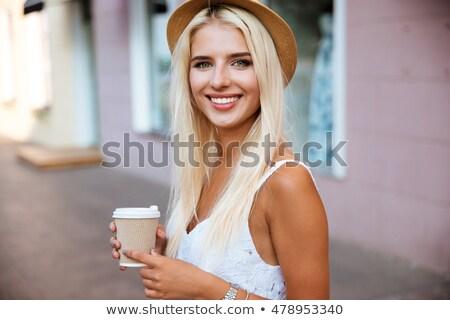 Közelkép lány kalap tart elvesz messze Stock fotó © deandrobot