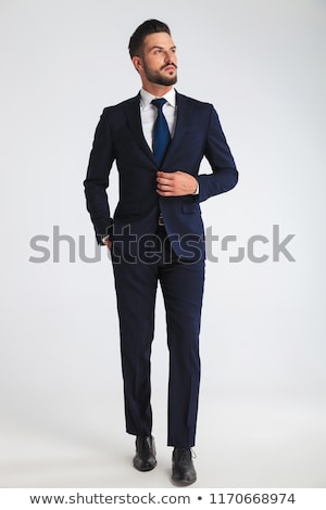 arrogant young business man looking to side  Stock photo © feedough