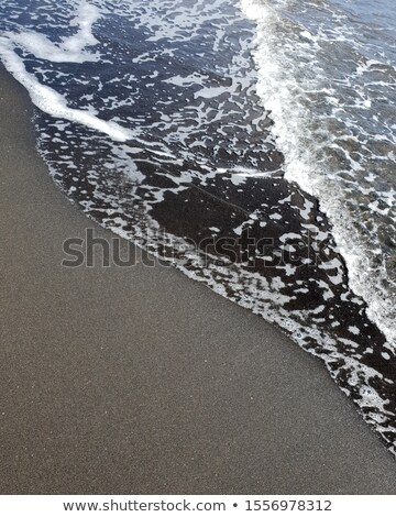 Stock photo: rock formations on sandy beach
