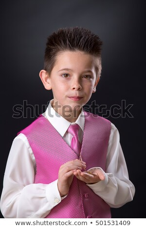 Young Boy Holding His Medals In His First Holy Communion Zdjęcia stock © BigKnell
