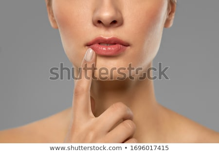 Pretty bare shouldered woman with fingers on neck Stock photo © dash