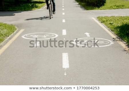 Shadow of unrecognizable cyclist on bicycle lane Stock photo © stevanovicigor