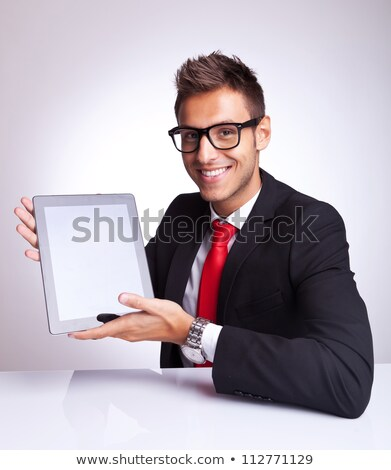 smiling business man showing blank laptop screen stock photo © deandrobot