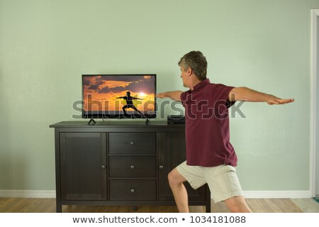 man practicing warrior 2 pose at beach stock photo © wavebreak_media