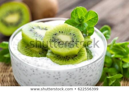 Fresh kiwi yogurt with fruits and chia seeds, healthy breakfast Stock photo © yelenayemchuk