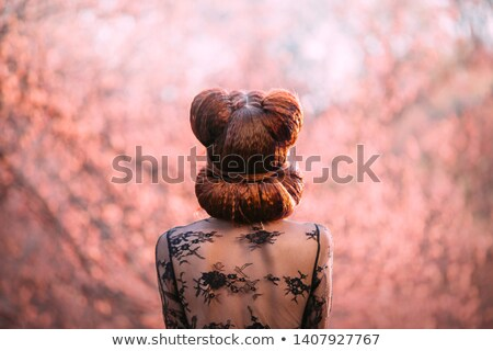 Black-haired woman twisting in red dress Stock photo © julenochek