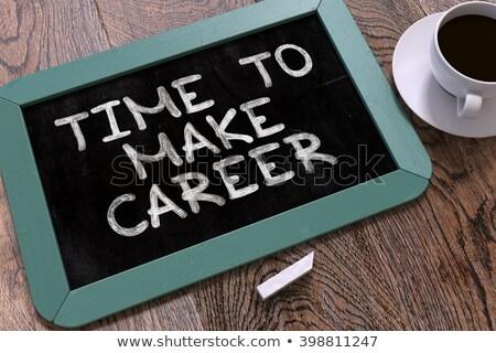 time to make career handwritten by white chalk on a blackboard stock photo © tashatuvango