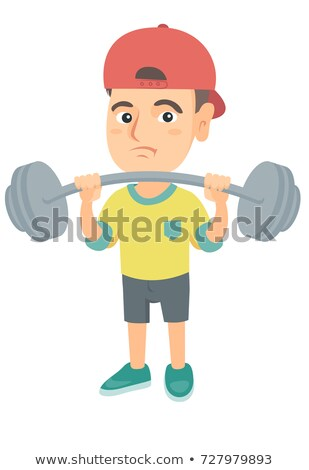 Upset caucasian boy lifting heavy weight barbell. Stock photo © RAStudio