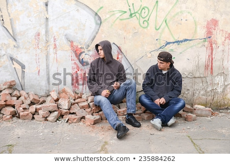 Teenage gang against graffiti wall Stock photo © IS2