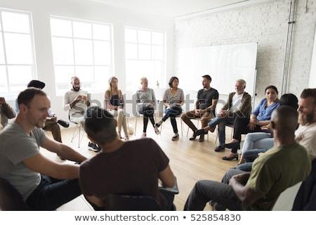Grupy ludzi posiedzenia kółko działalności kobieta biuro Zdjęcia stock © IS2