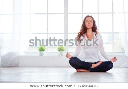 Retrato bastante mujer sesión yoga Foto stock © deandrobot