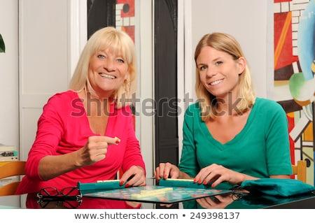 boldog · idős · nő · játszik · nők · asztal - stock fotó © FreeProd