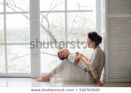 Parents with baby son in living room Stock photo © IS2