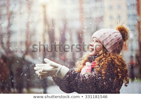 Young girl with snow falling on her Stock photo © IS2